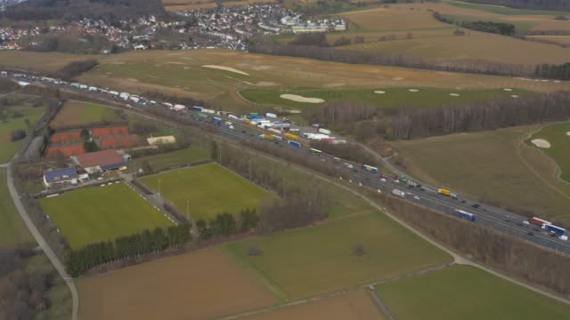 Aerial of Autobahn A8 close to Karlsruhe Aerial of Autobahn A8 close to Karlsruhe pannin along the Autobahn with traffic jam. autobahn stock videos & royalty-free footage