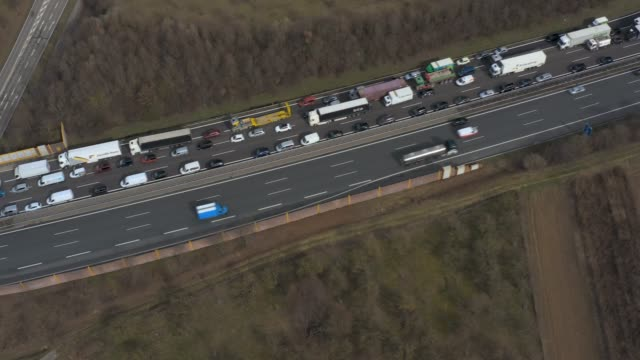 Aerial of Autobahn A8 close to Karlsruhe Aerial of Autobahn A8 close to Karlsruhe with traffic jam from high above panning along the cars autobahn stock videos & royalty-free footage