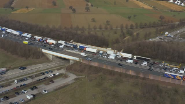 Aerial of Autobahn A8 close to Karlsruhe Aerial of Autobahn A8 close to Karlsruhe with traffic jam on bridge. autobahn stock videos & royalty-free footage