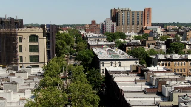 Aerial of Bushwick in Brooklyn, New York on a Sunny Summer Day Aerial drone footage of Brooklyn, New York on a sunny summer day. Includes views of the NYC Skyline and various art and murals on warehouse walls. mural stock videos & royalty-free footage