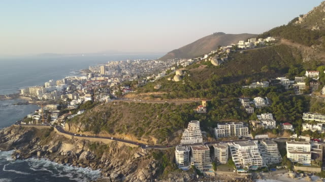 Aerial of Clifton Beach along Atlantic Seaboard and Signal Hill in Cape Town video