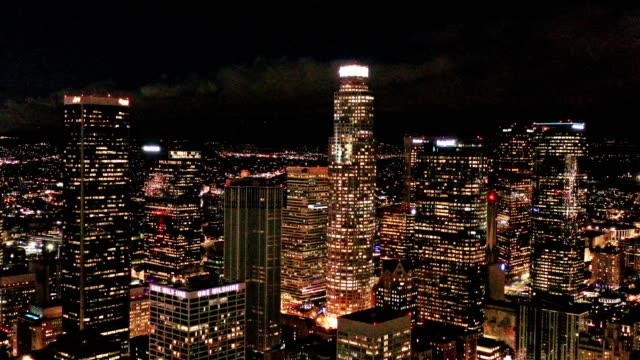 aerial of downtown los angeles california at night - città diffusa video stock e b–roll