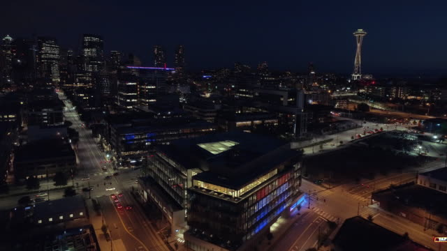 Aerial of Downtown Seattle Lit at Night with Cars Driving on City Streets Helicopter shot of world famous landmark on dark evening in Pacific Northwest seattle stock videos & royalty-free footage