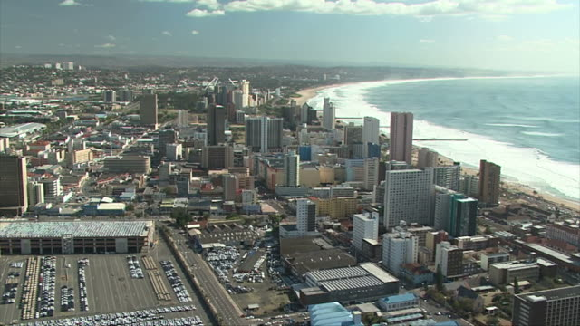 Aerial of Durban's beachfront and city. Aerial of Durban's beachfront and city showing the Indian Ocean and hotels. natal stock videos & royalty-free footage