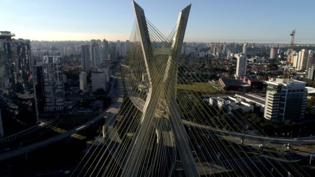 Aerial of Estaiada Bridge, Octavio Frias traffic at Estaiada bridge, Octavio Frias, in São Paulo atsunrise marginal pinheiros stock videos & royalty-free footage