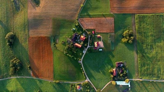 aerial of farmland scenic landscape at sunrise - farm stock videos & royalty-free footage