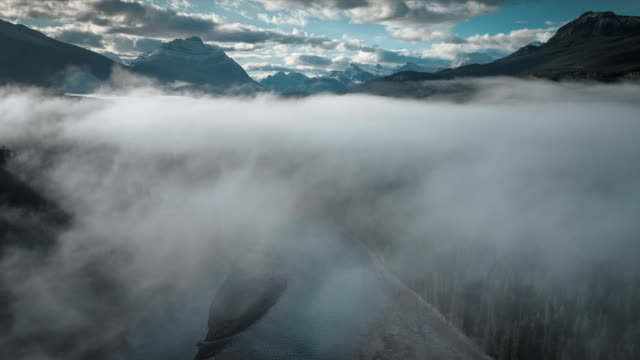 aerial of fog over athabasca river in jasper video