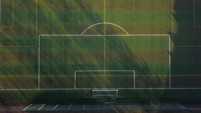 aerial of football pitch with artificial green turf - football field stock videos & royalty-free footage