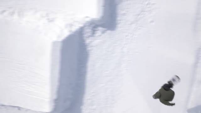 Aerial of freestyle snowboarder performing a big air jump video