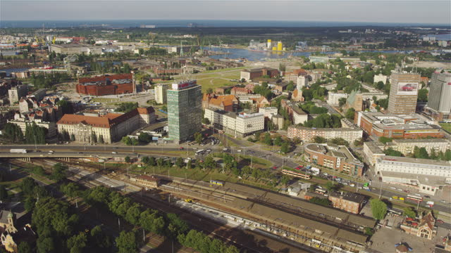 Aerial of Gdansk old town houses and churches and Motlawa River with vintage tourist boat