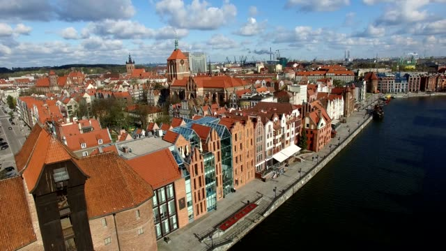 Aerial of Gdansk Old Town Houses Churches and Motlawa River Aerial of Gdansk Old Town Houses Churches and Motlawa River eastern europe stock videos & royalty-free footage