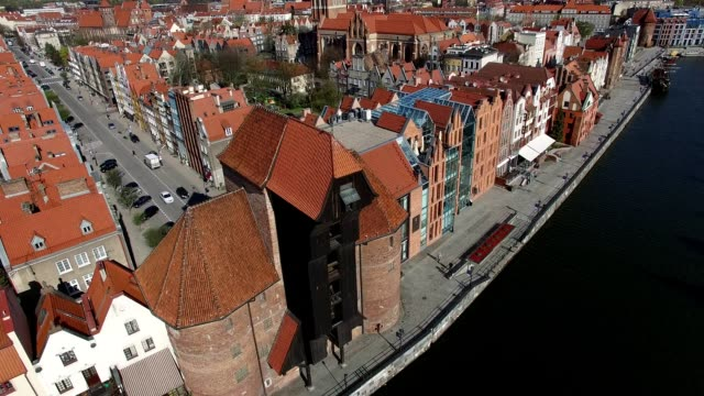 Aerial of Gdansk Old Town Houses Churches and Motlawa River video