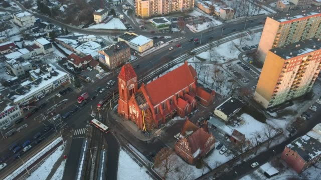 Aerial of Gothic Brick Church Surrounded by Blocks of Flats in Winter Aerial of Gothic Brick Church Surrounded by Blocks of Flats in Winter gdansk stock videos & royalty-free footage