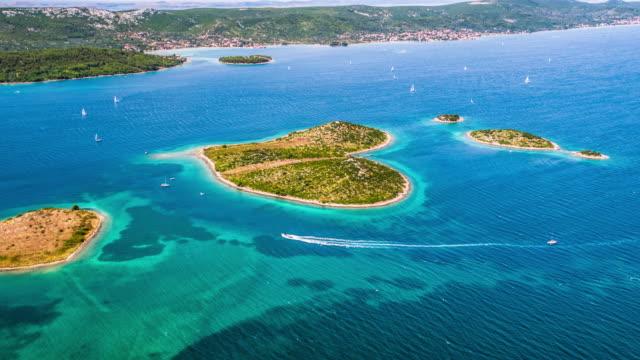 aerial of heart shaped island galesnjak in croatia - хорватия стоковые видео и кадры b-roll