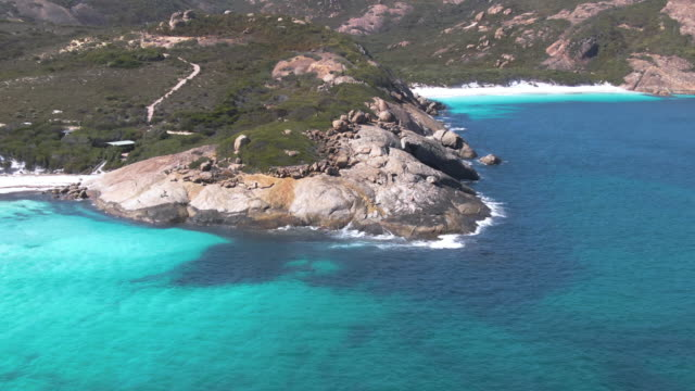 Aerial: of Hellfire bay, Thistle cove and Lucky Bay in Esperance with turquoise waters and granite domes in the untouched wilderness of Cape Le Grande National Park. Western Australia Tourism.