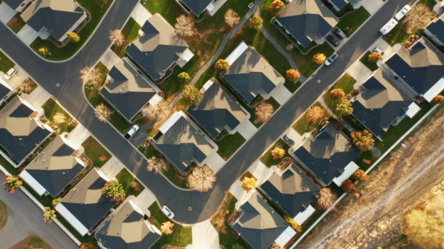 Aerial of Homes in Autumn Sunlight