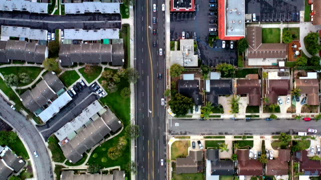aerial of houses in california suburbs - città diffusa video stock e b–roll