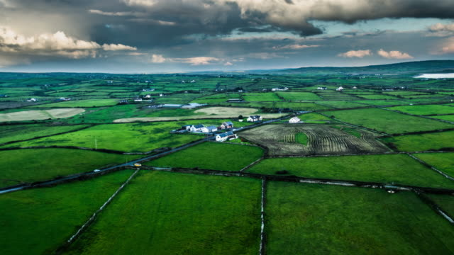 Aerial of patchwork landscape with green fields in Ireland video