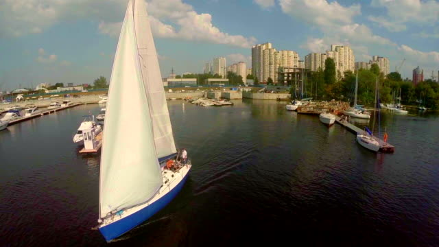 aerial of sailboat leaving dock. summer vacation, active rest - port wine stock videos & royalty-free footage