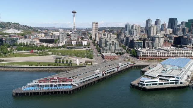 Aerial of Seattle, Washington Tourist Attraction the Waterfront Piers with World Famous Landmark in City Skyline video