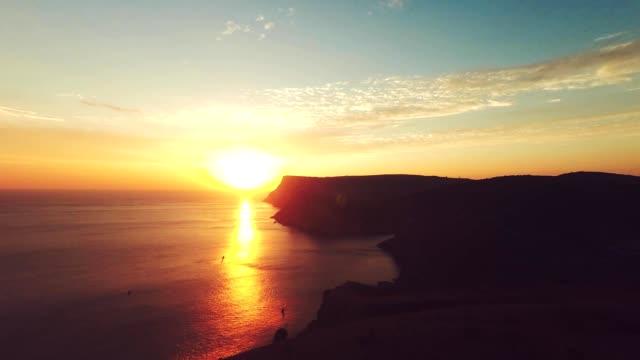 Aerial of sunset. Timelapse sunrise in the mountains. Bike riders. Sea coast. Cave city Mangup-Kale, Crimea. Plateau. video