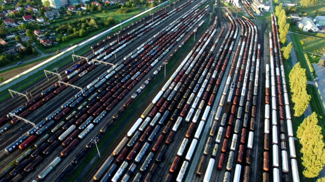 aerial of tanker freight trains in train depot - nave cisterna video stock e b–roll