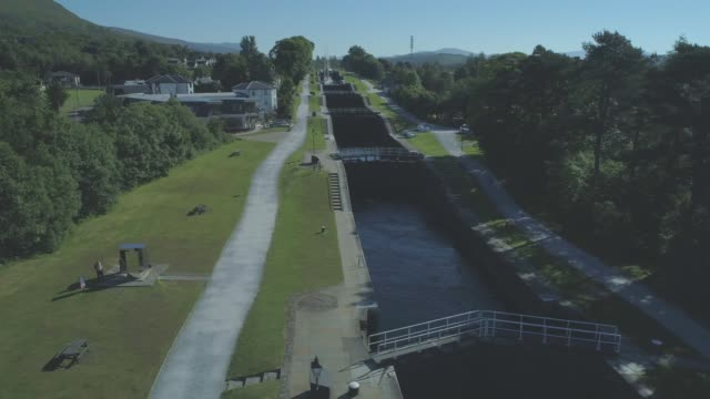 aerial of the neptune's staircase series of locks on the caledonian canal in banavie, fort william, scotland - fort william video stock e b–roll
