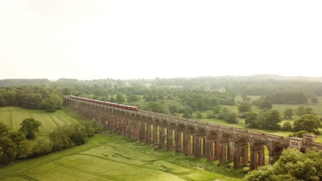 aerial of the ouse valley viaduct across the river ouse in sussex england - sud est video stock e b–roll
