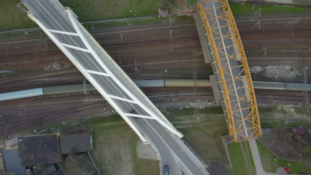 Aerial of Train Going Under Road Overpass Aerial of Train Going Under Road Overpass gdansk stock videos & royalty-free footage