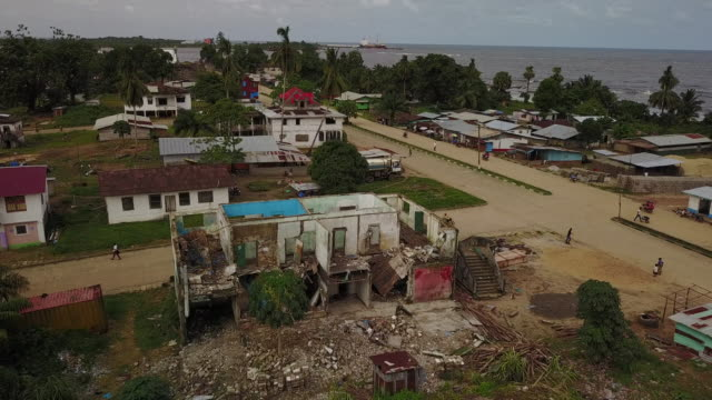 aerial of war damaged bombed out building in third world country - liberia video stock e b–roll