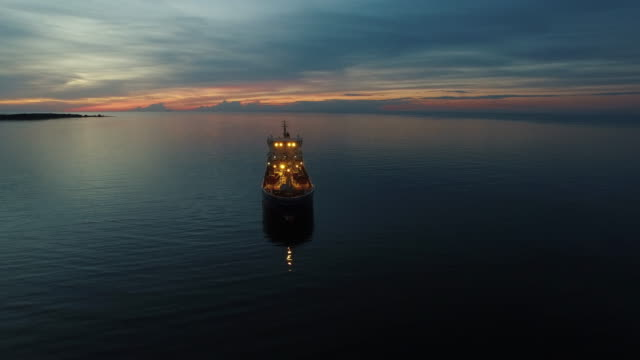 Aerial Orbit Shot of Tanker Ship Moving in Sea at Night Aerial Orbit Shot of Tanker Ship Moving in Sea at Night. Shot on RED Cinema Camera in 4K (UHD). industrial ship stock videos & royalty-free footage