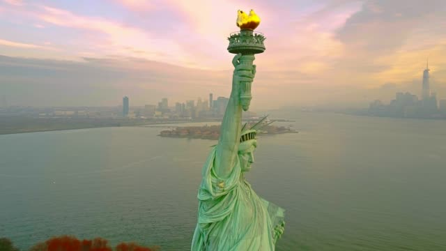 Aerial Orbiting Statue of Liberty 4k Aerial shot Statue of Liberty 4K fourth of july videos stock videos & royalty-free footage