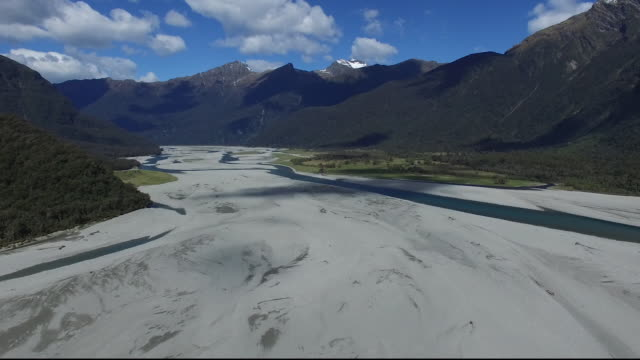 Aerial Over Sandy River Basin Surrounded By Mountains