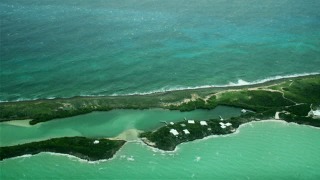 Aerial Over Slim Tropical Island Aerial over a slim, tropical island turks and caicos islands stock videos & royalty-free footage