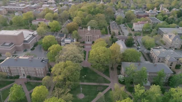 Aerial over the University of North Carolina in the Spring Aerial over the University of North Carolina at Chapel Hill in the spring. military private stock videos & royalty-free footage