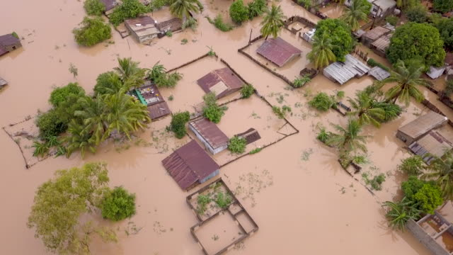 aerial overhead flooded village in rural country - climate change video stock e b–roll