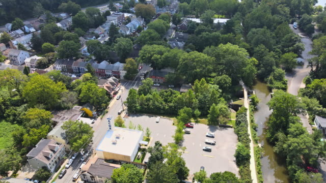 Aerial overhead landscape neighborhood in a small American town of Lambertville New Jersey, view of Delaware river near small town historic New Hope Pennsylvania USA