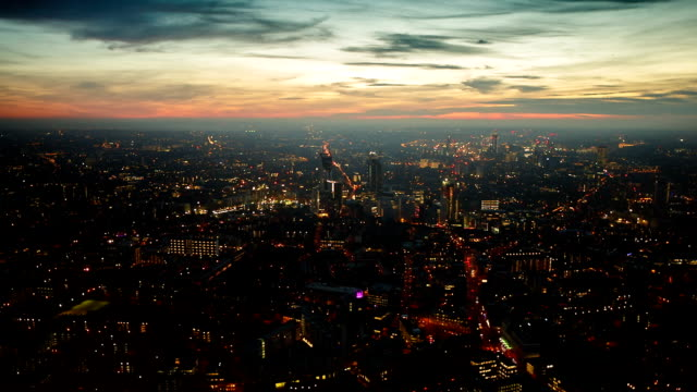 Aerial panning shot of the West London skyline during late evening with street lights video