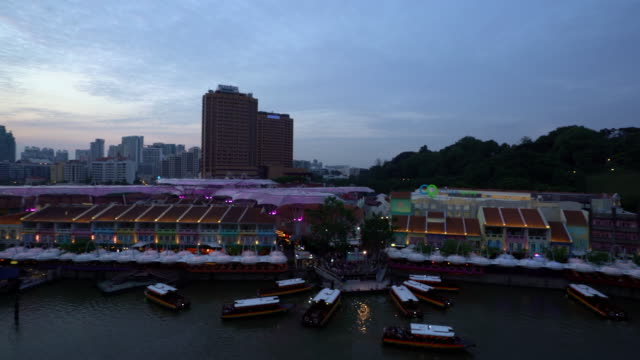 Aerial panning shot: People crowd at Clark Quay Sunset video