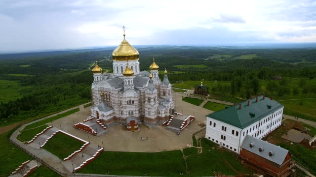 aerial panorama of  big white monastery with golden dome video
