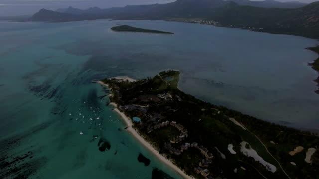 aerial panorama of ocean and mauritius island - isole mauritius video stock e b–roll