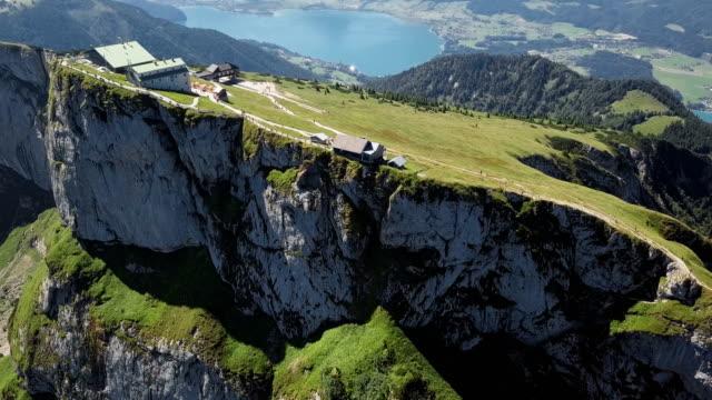 vídeos de stock e filmes b-roll de aerial panorama of schafberg viewpoint in salzkammergut, upper austria - isolated house, exterior