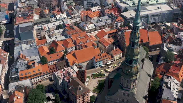 riga, latvia - may, 2019: aerial panorama view of the old town of riga by the st. peters cathedral. - латвия стоковые видео и кадры b-roll