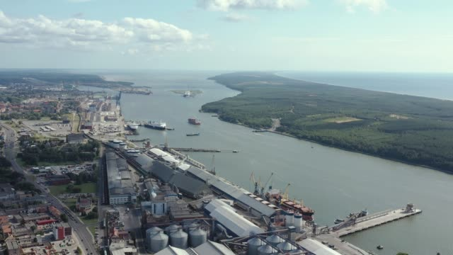 KLAIPEDA, LITHUANIA - JULY, 2019: Aerial panorama view of the port of Klaipeda and seascape of Baltic sea. KLAIPEDA, LITHUANIA - JULY, 2019: Aerial panorama view of the port of Klaipeda and seascape of Baltic sea from above. coathanger stock videos & royalty-free footage