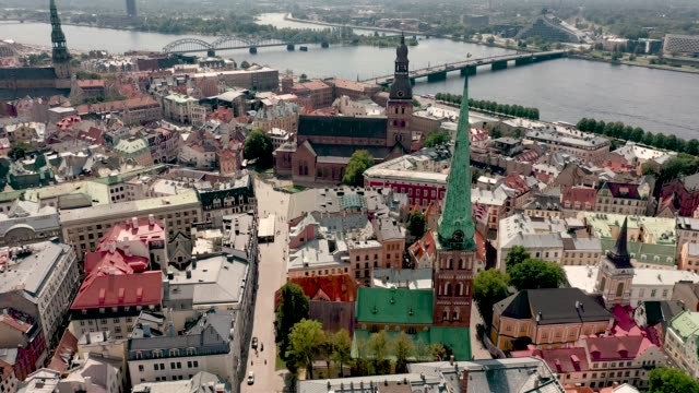 riga, latvia - may, 2019: aerial panorama view of the roofs, riga's cathedrales and city landscapes near daugava river. - латвия стоковые видео и кадры b-roll