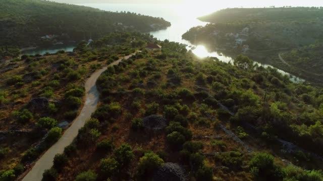 aerial panoramic sunset view of brac island. - хорватия стоковые видео и кадры b-roll