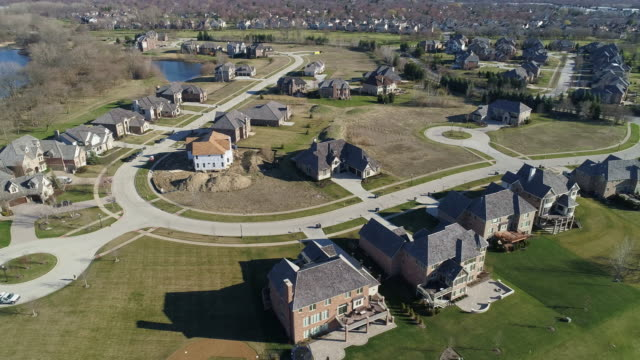 Aerial panoramic view of the residential neighborhood Libertyville, Vernon Hills, Chicago suburban area, Illinois. Cinematic aerial drone video with the wide panoramic-orbit camera motion.