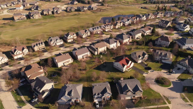Aerial panoramic view of the residential neighborhood Libertyville, Vernon Hills, Chicago suburban area, Illinois. Cinematic aerial drone video with the forward and tilting-down camera motion.