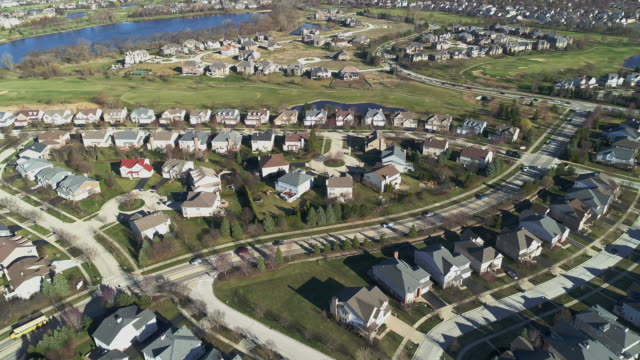 Aerial panoramic view of the residential neighborhood Libertyville, Vernon Hills, Chicago suburban area, Illinois. Cinematic aerial drone video with the backward camera motion.