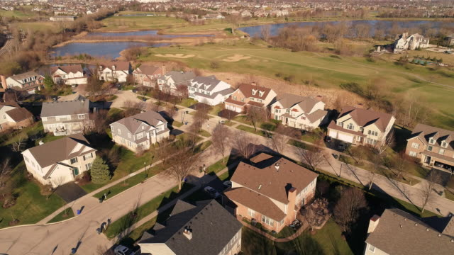 Aerial panoramic view of the residential neighborhood Libertyville, Vernon Hills, Chicago suburban area, Illinois. Cinematic aerial drone video with the ascending camera motion.